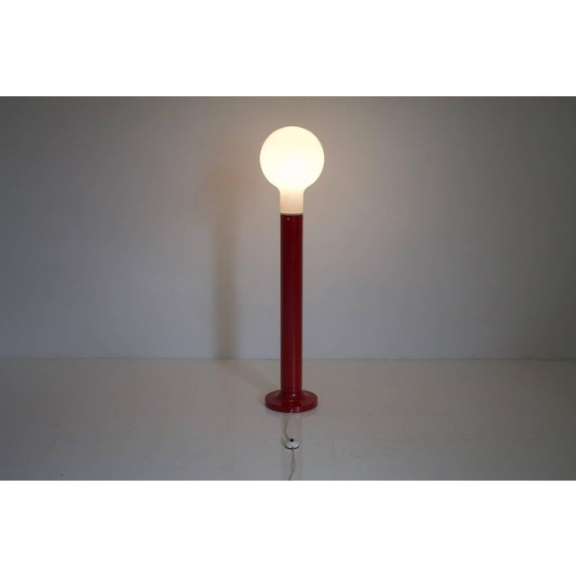 Kaiser floor lamp with glass and red lacquered metal base, Germany, 1970s Very good condition.