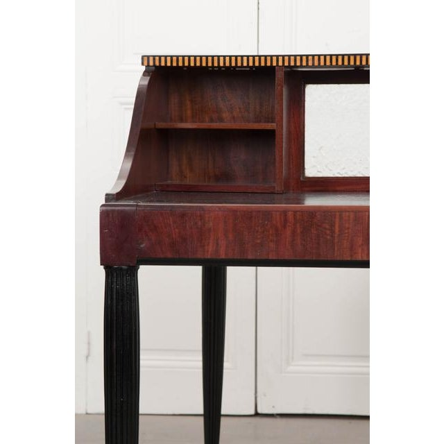 A stylish mahogany Art Deco partners desk, made in France circa 1920. The two-man desk is separated by eight (total)...