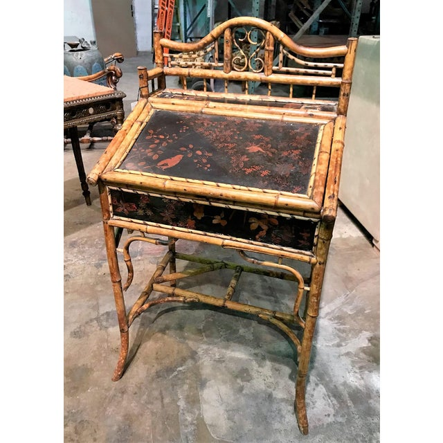 19th century English bamboo slope front writing desk with Oriental motif lacquered panels decorated with birds in a...