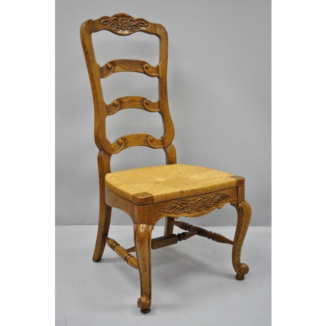 Vintage Bernhardt Oak Wood Ladder Back Dining Side Chair with Woven Rush Seat Details: Solid oak wood construction, woven...