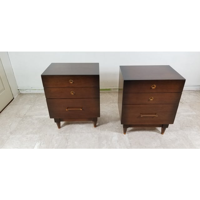 Pair of modern night stands made out of walnut wood. Approximately made in 1970's. They're in original condition. Very...