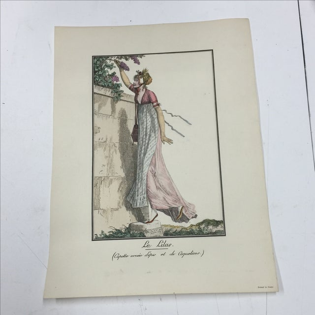 Printed in France. Beautiful print of woman smelling the lilacs. Minor light marks in white border of paper. Slight curve...