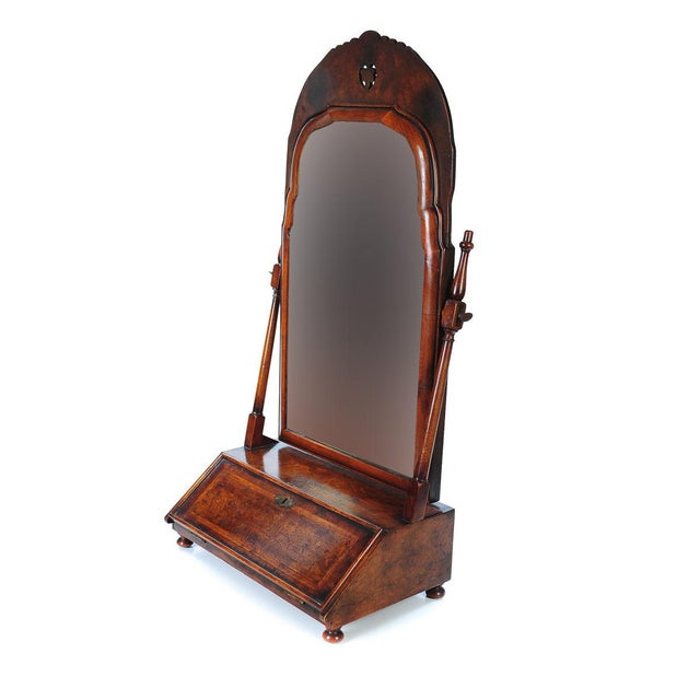 19th century carved walnut shaving mirror with a small drop front cabinet.