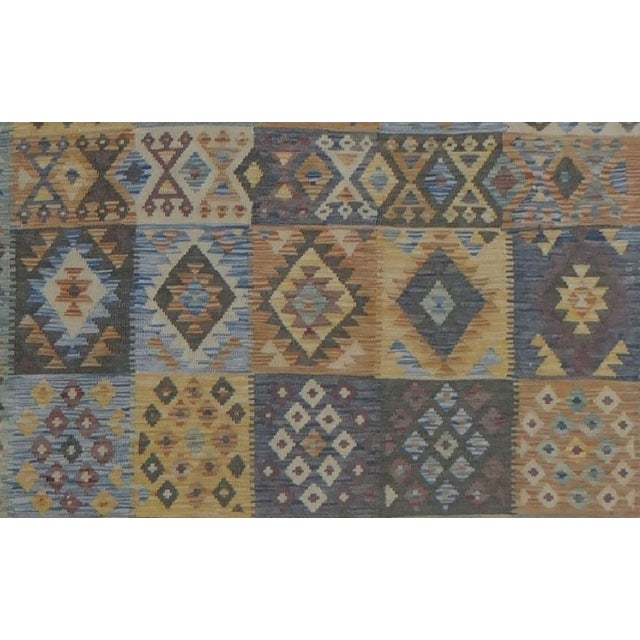 A beautiful hand-knotted kilim by Aara Rugs Inc. made of 75% wool & 25% cotton, dyed with all natural dyes made from...