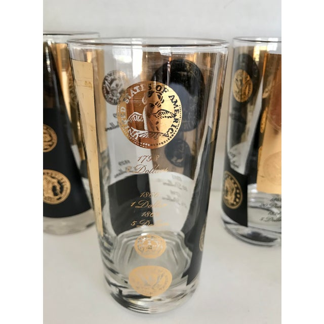This is a fantastic set of glasses by Cera from the mid-century, which feature coin details in black and 22k gold! There...