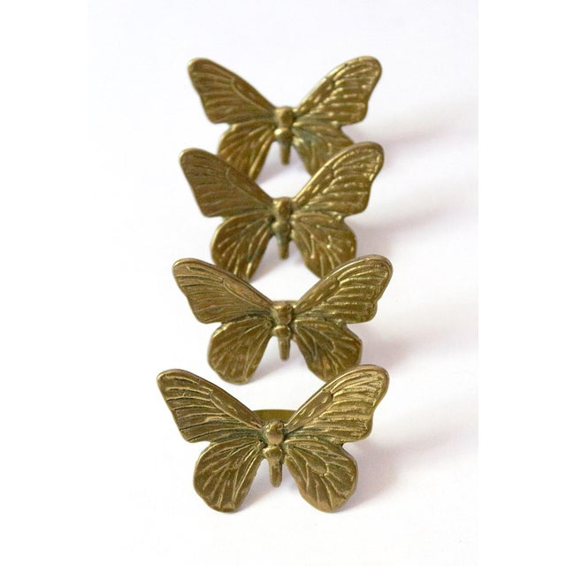 A gorgeous & unusual set of brass napkin rings, shaped as butterflies. Solid & weighty for their size, each appears...