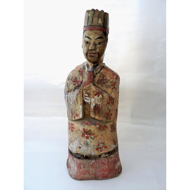 Antique polychrome figure of a robed Chinese scholar on a base plinth. Hand carved and painted throughout. The figure is...