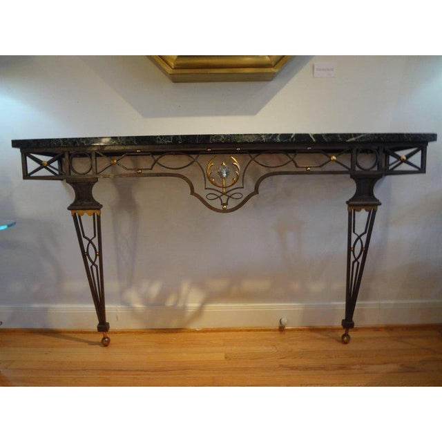 Outstanding French Neoclassical style wrought iron console table attributed to Gilbert Poillerat, 1940s. This stunning...