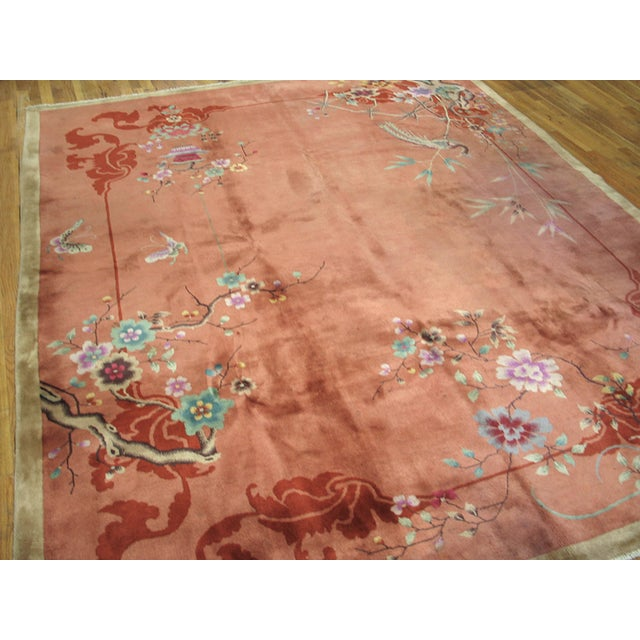 Antique Chinese Art-Deco Rug with red background with floral design.