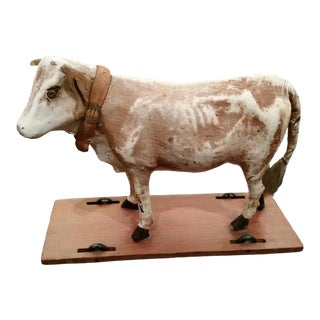 Early 20th Century Antique Cow Hide Mooing Cow Pull Toy on Wheeled Base For Sale