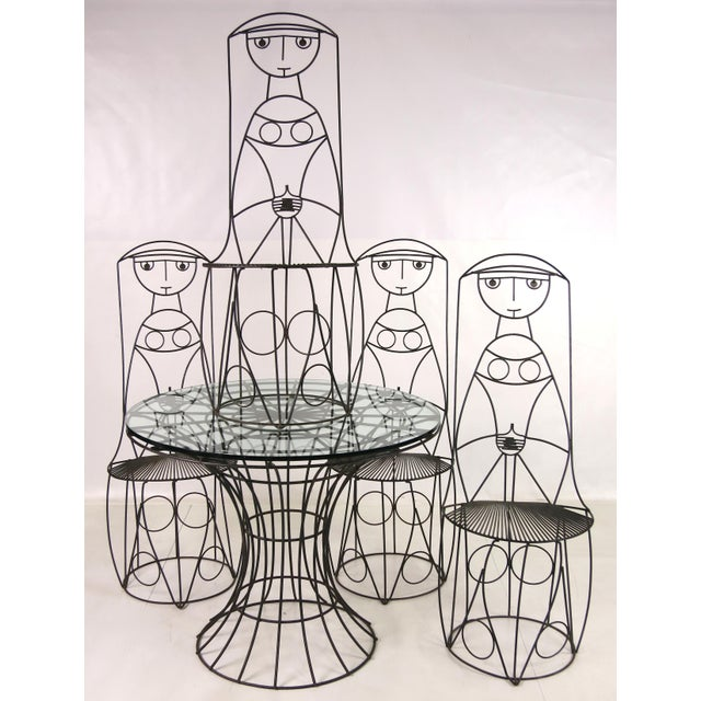 """Four """"Nun"""" chairs and table in steel by John Risley. Flush glass top (shown) is 36"""" but can easily accommodate a 48"""" or..."""