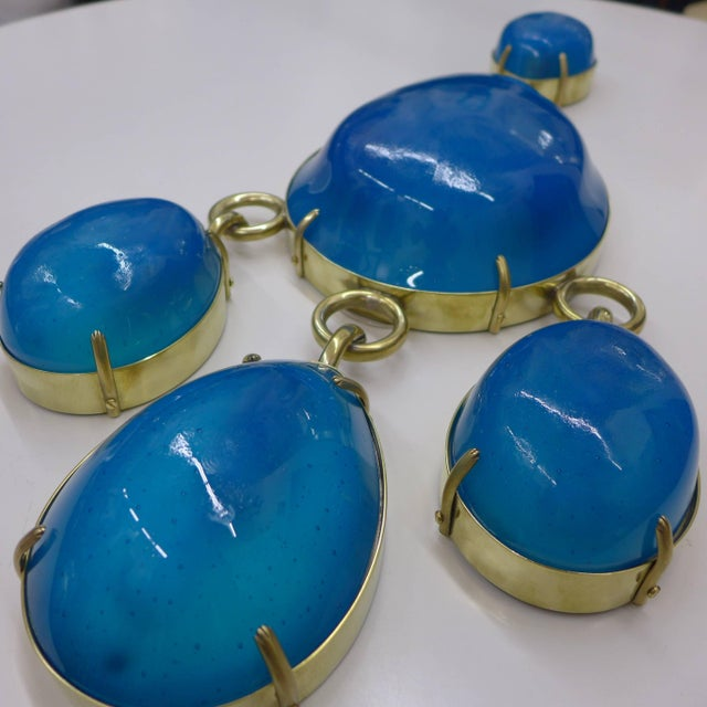 Handmade aquamarine glass and brass sconces. Limit edition. Capacity: 5 x E12 25Watts Different glass colors and metal...