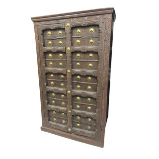 Antique Indian Hand Carved Teak Earthing Brass Medallion Armoire Cabinet For Sale
