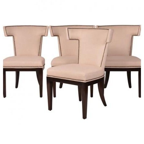 The ultimate detailed Klismos dining chair. The silhouette of the classic back is outlined in hand applied nailheads and...