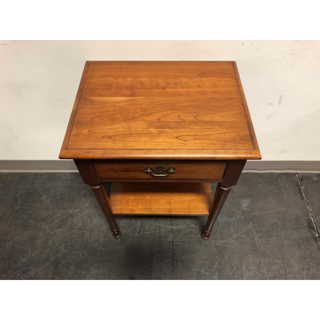 A vintage nightstand in the Chippendale style by Cherry Hill Collection. Made in the USA in the late-mid 20th Century....