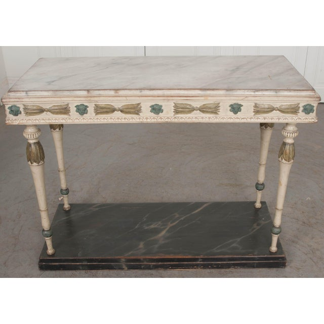 Charming and spectacular, this remarkable 19th century Swedish console provides your space with warmth while not...