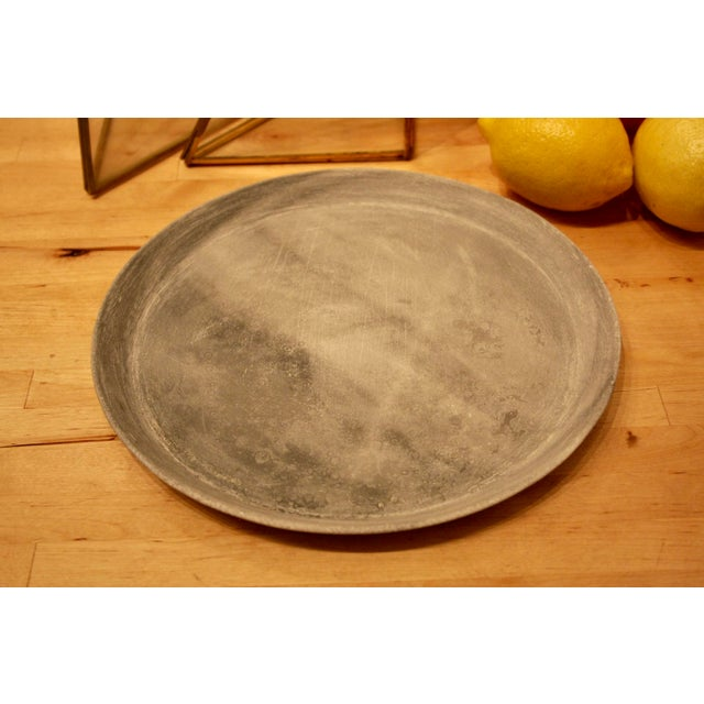 Delicate, minimalist and rustic all come together in describing this lovely carved marble dish. We've shown this with...