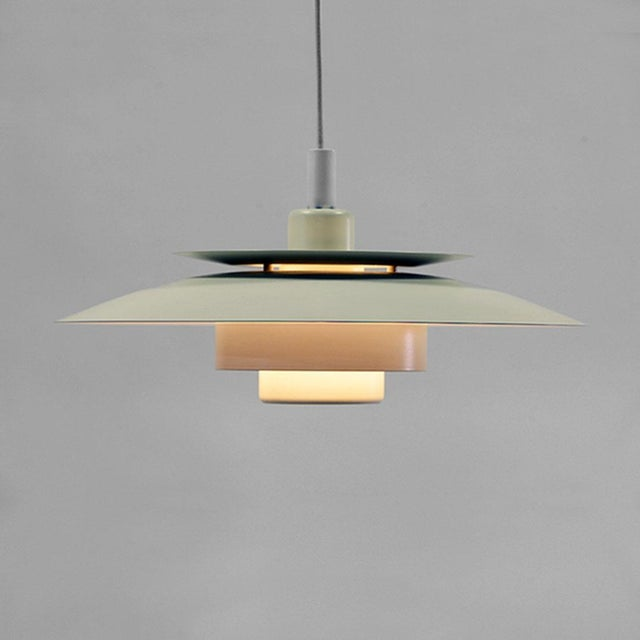 This is a very elegantly sleek pendant light by Simon P. Henningsen for Danish lighting producer Lyskaer Belysning. Simon...