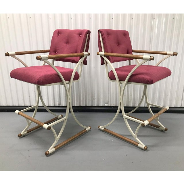 Stylish pair of high bar stools in the style of Cleo Baldon, circa early 1970s. The back and seat cushions have been newly...