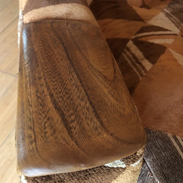 Beautiful accent chair with authentic vintage Upholstery. The chair features walnut hand rests and hand carved base....
