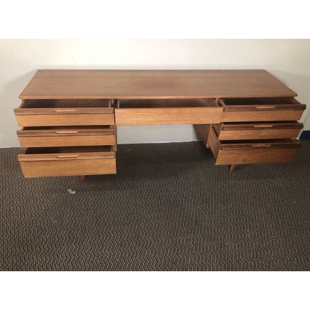 Fantastic mid-century teak vanity or low desk. Made in England. Very good vintage condition. All the drawers glide well....