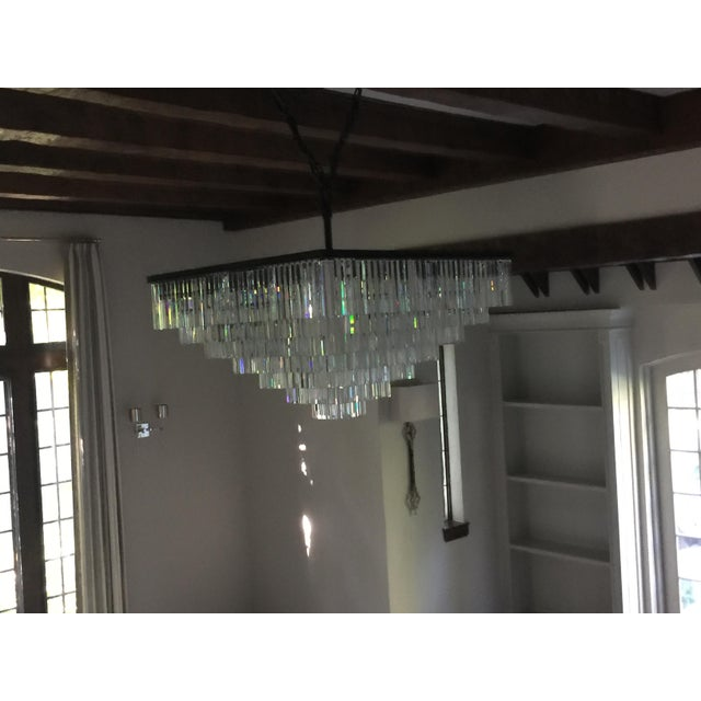 Here is a vintage 1920s seven-tiered chandelier featuring a fringe style layering of Odeon clear glass. This fixture came...