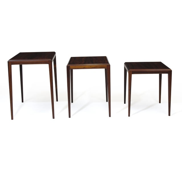 Set of three rosewood nesting tables designed by Johannes Andersen produced by CF Christensen of Silkeborg, Denmark....
