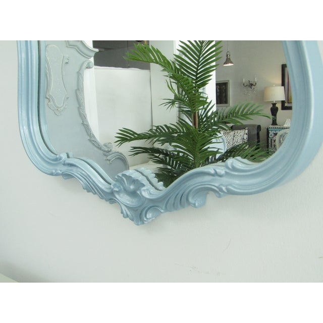 In our showroom, this stunning mirror hangs with a pair of sconces in the same (Pearlescent Icy Mist) Metallic Blue Paint....