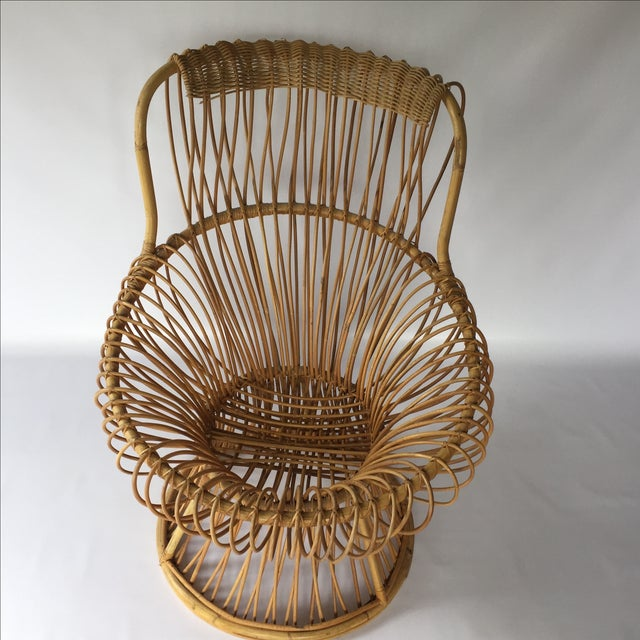 Mid-century rattan chair in the style of Franco Albini. In very good condition with some very minor wear. No broken rattan.
