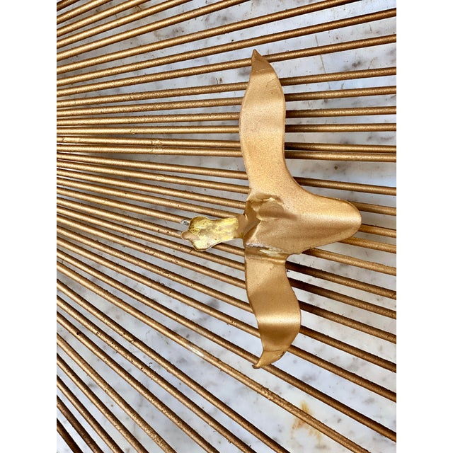 A Brass Sunburst Birds in Flight Wall Sculpture by William Friedle, United States, c.1960. This Wall Sculpture would look...
