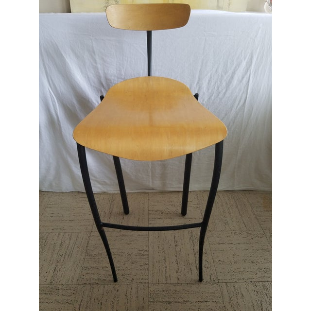 Market found, I love the modern nature of these wood sear and back black metal barstools. No makers mark.