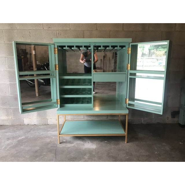 Mint condition mid century bar cabinet in a lovely lacquered Mint hue will be a conversation piece in any room! Wide...