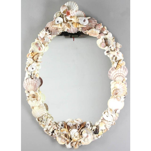 Vintage shell encrusted mirror, oval design, the 1950s. Handmade in the 1950s from all-natural shells. Perfect mirror for...