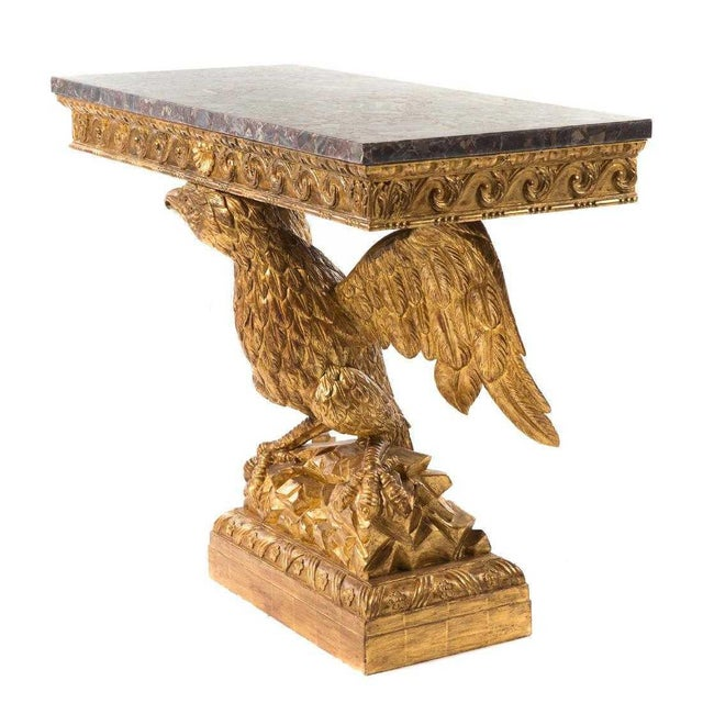 George II style carved giltwood eagle console n the manner of William Kent, 20th century; rectangular grey breccia marble...