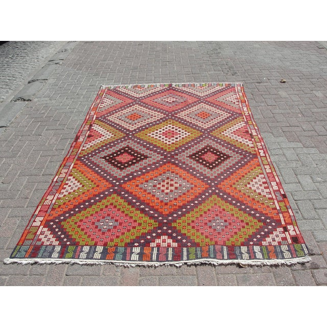 Vintage handwoven Turkish kilim rug. The kilim is nearly 45 years old. It is handmade of very fine quality natural wool in...
