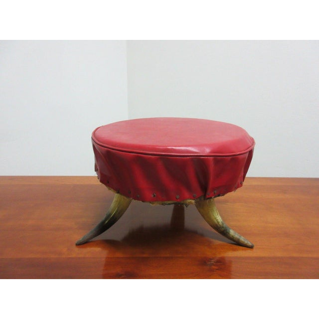 An antique cow horn footstool.Great shape, sturdy and tight... some light wear. Please see photos as they are considered...