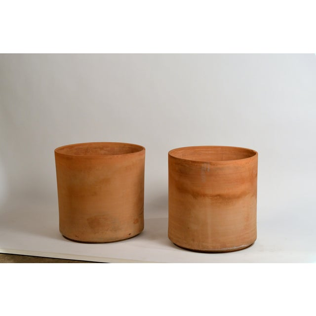 Pair of huge unglazed architectural terracotta planters by Gainey Ceramics. Rare as a pair in that size with the unglazed...