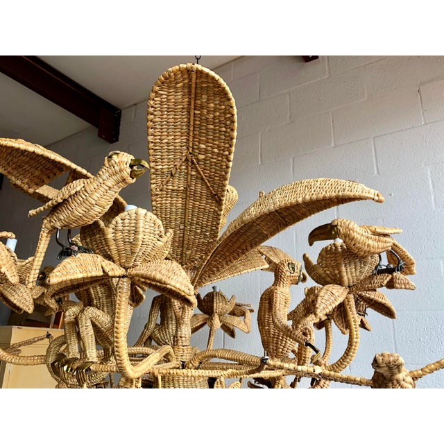 Mario Lopez Torres handmade wicker chandelier made of palm and chuspata over an iron frame with monkeys, birds, gators,...