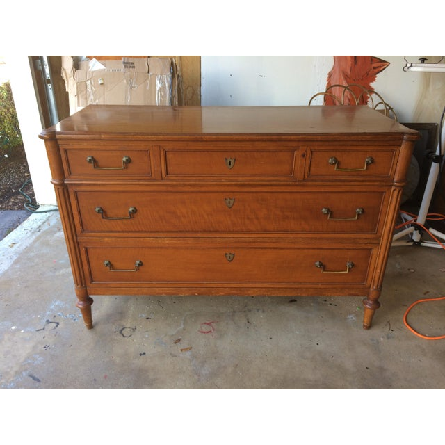 This dresser came from a Chicago area estate. There are some surface scratches. Had thought of painting it but I think it...