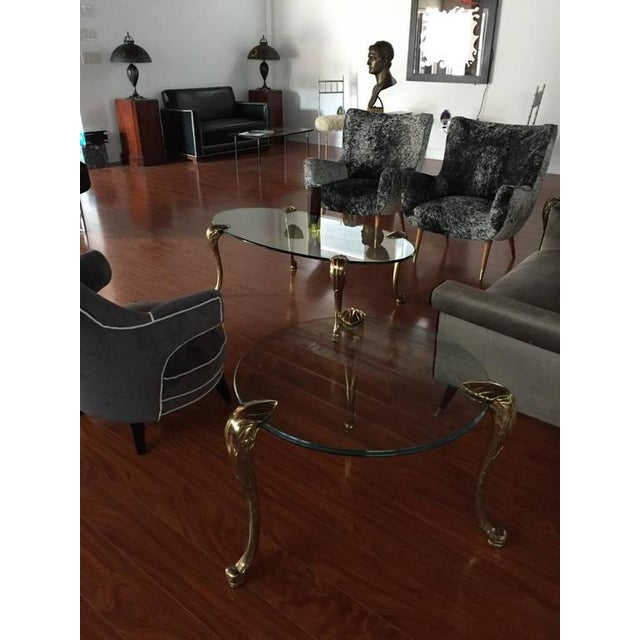 Mid-Century Modern brass and glass end table. Inquire about matching coffee table. Diameter of just the glass 27 inches.