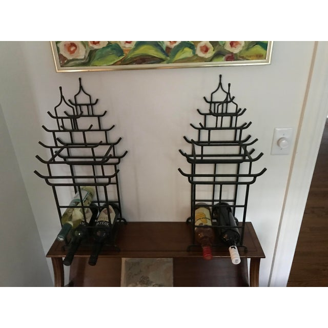 Pair of charming pagoda shaped wine storage containers. Empty bottles can be stored on points. Black iron sturdy...
