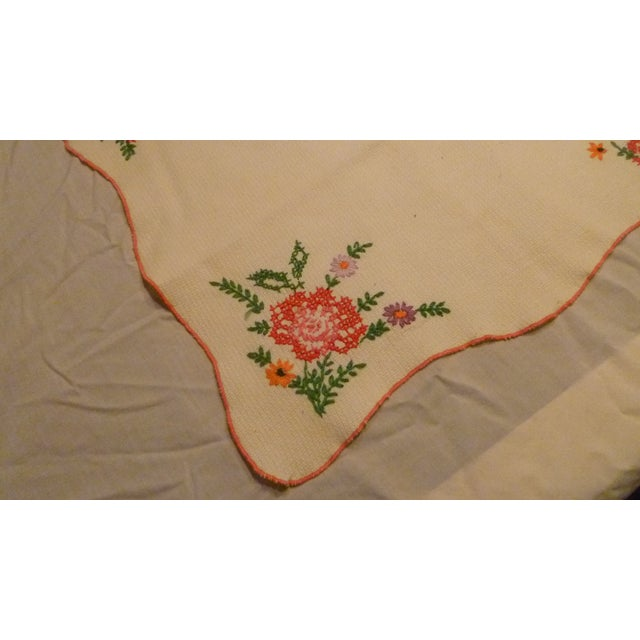 This is a lovely handmade embroidered linen. Vibrant sewn colors and quality scalloped rolling edging. Edged with tight...