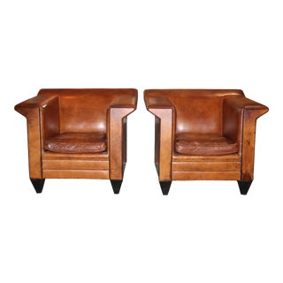 Pair of European Art Deco Even-arm Club Chairs in Caramel Leather For Sale