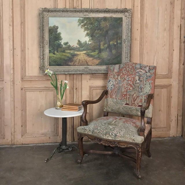 Antique French Louis XV Armchair with Tapestry features the gracefulness of the style, with subtly arched seatback,...