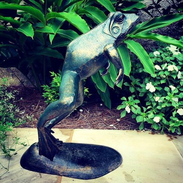 A leaping frog fountain, green and bronze surface with lily pad base, plumbed with copper tubing.