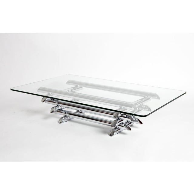 This elegant Mid-Century coffee table is from Paris, France, circa 1960. This piece features beautiful clean lines and its...