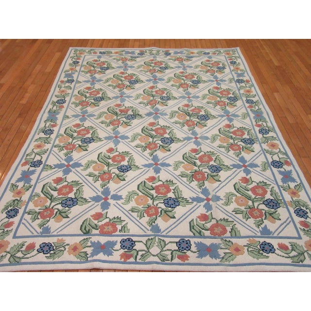 This is a new hand woven needlepoint rug made in India with a famous Portuguese style. It is made with wool in a trellis...
