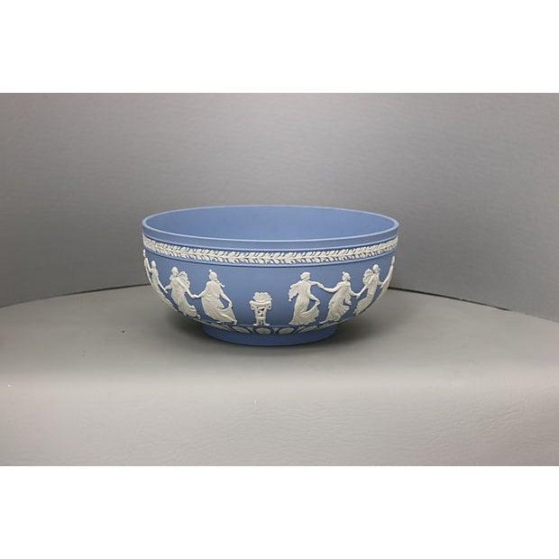 """Highly collectable large Wedgwood Jasperware bowl in the """"Dancing Hours"""" pattern. Maker's mark on underside."""