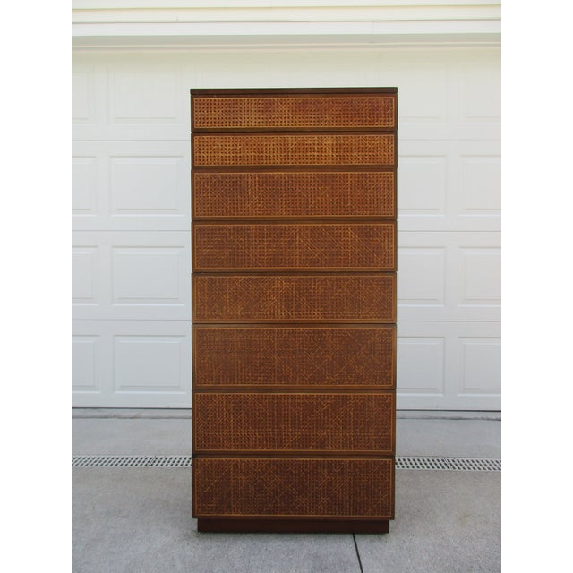 A rare eight drawer woven cane front and side panel dresser by Directional. Directional has long been a sought-after brand...