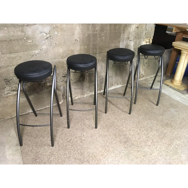 Set of four unique post modern bar stools. Painted steel bases in very Memphis post modern style (definitely designer but...